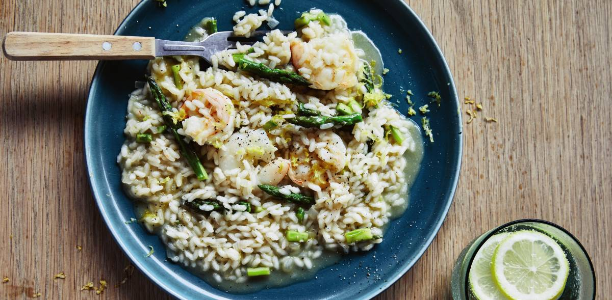 How to cook the perfect risotto with asparagus and prawns. Picture: Rob Palmer