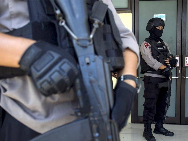 Indonesian police and the military are hunting for suspected militants who killed four people.