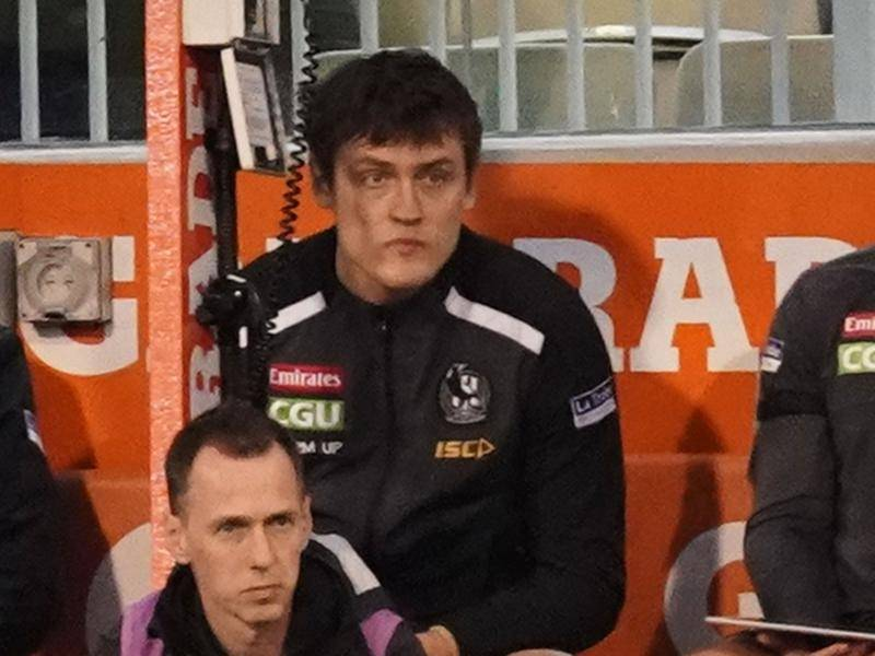 Collingwood's Darcy Moore sits on the bench, coming off during the Magpies' win against Essendon.